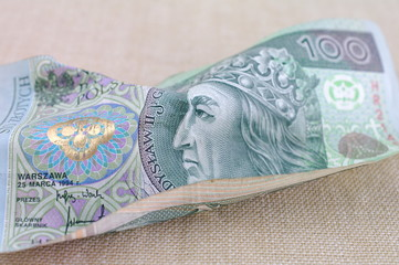 Fototapeta Zniszczony banknot sto złotych obraz