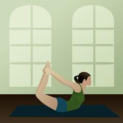 Young woman practicing yoga Bow Pose( Dhanurasana)
