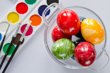 ester eggs with brush and paint