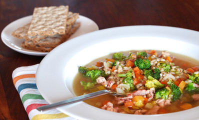 Rabbit soup with barley and vegetables with rye crisp bread
