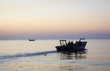 Fishermen go out to work. Morning on the Yellow Sea, China, Qinh