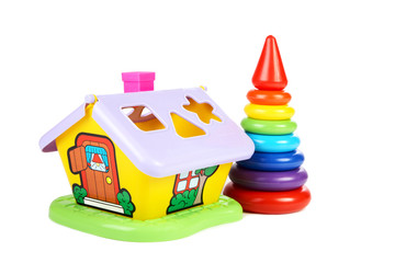 Children's toys  small house and  pyramid on a white