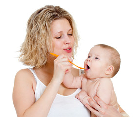 mother feeding  her baby by spoon