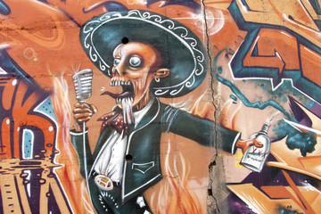 Graffiti de un hombre cantando, arte urbano