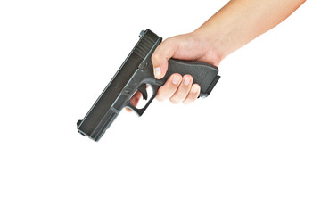 Airsoft hand gun, glock model with hand aim on the floor