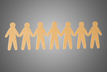 team of paper people on grey background