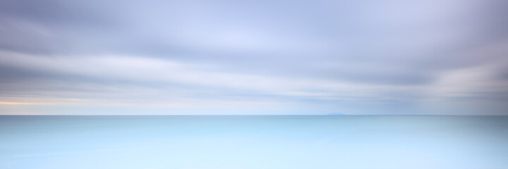 Long exposure photography panorama 3:1 with soft sea and cloudy