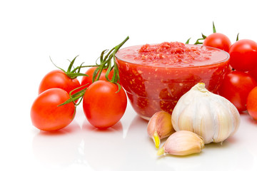 tomato sauce and ingredients on a white background