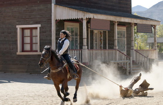 Sheriff drags a Bandit by rope at Mini Hollywood