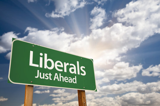 Liberals Green Road Sign and Clouds