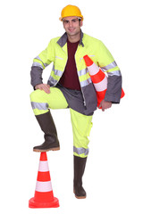 Poster Superheroes Worker with foot on top of cone signaling