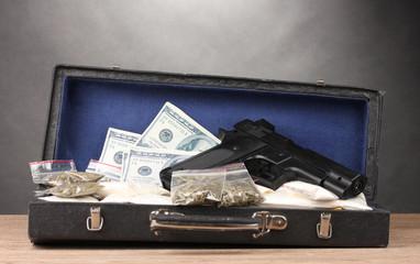 Cocaine, marijuana dollars and handgun in case