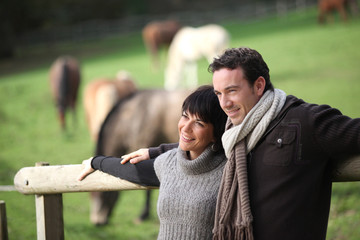 Couple standing in a paddock