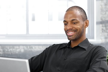 Happy handsome afro man