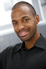 Closeup portrait of smiling black man