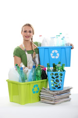 A woman recycling plastic bottles.