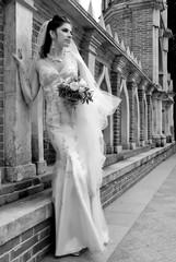 Beautiful bride near the castle walls