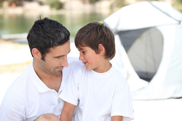 Family and son camping together