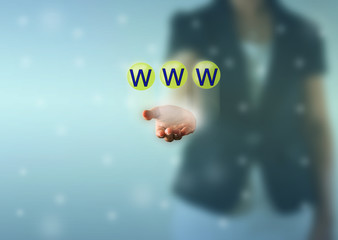 Business woman hand and WWW words show in green crystal ball