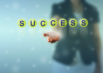 Business woman hand and SUCCESS words show in green crystal ball