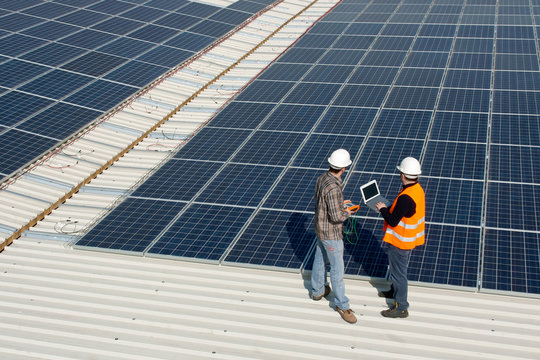 Men working on a photovoltaic plant
