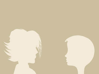 two heads silhouette on brown background