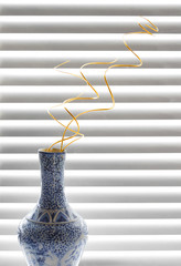 decorative vase with spiral branches