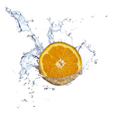 Deurstickers Opspattend water Orange juice splashing isolated on white