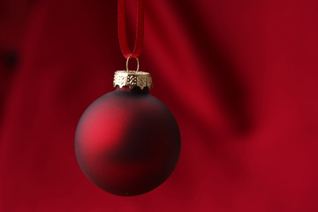 illustration of single red Christmass ball on red background
