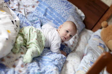 Baby on parents's bed