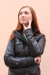 Pretty redhead young woman thinking