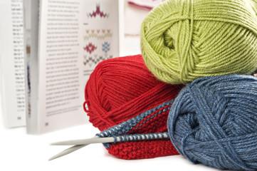 Yarn needles pattern and knitting on white