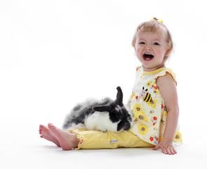 Bunny Rabbit in a little girls Lap