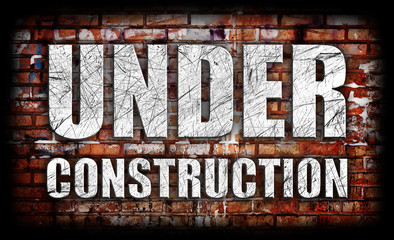 Under Construction on brick wall