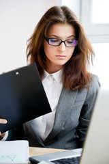 Pretty business woman working at her office