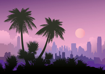 Silhouette of palm trees on the city background.