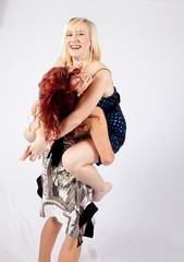 redhead and blond girls playing together
