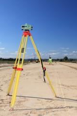 geodesist taking measurement