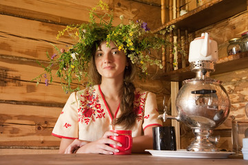 Girl with traditional russian samovar