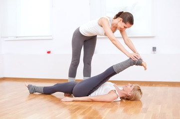 Women doing yoga exercise at gym