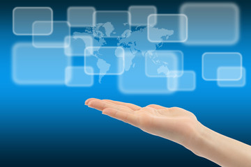 Woman hand with touch screen interface and world map