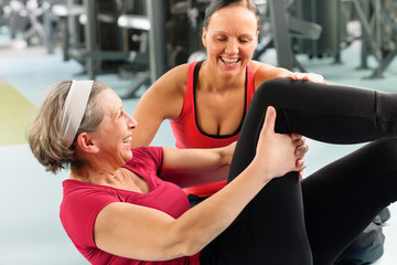 Fitness center senior woman exercise gym workout