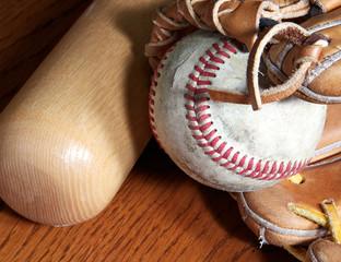 baseball mitt, ball and bat
