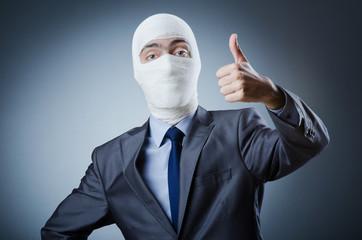 Man covered in medical bandages