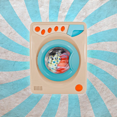 Concept of a colorful washing machine with a retro background