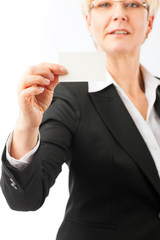 Mature woman showing her business card