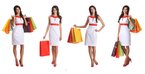 Four young women in summer dresses and holding bags