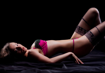 Fashion shoot of a young woman in erotic lingerie