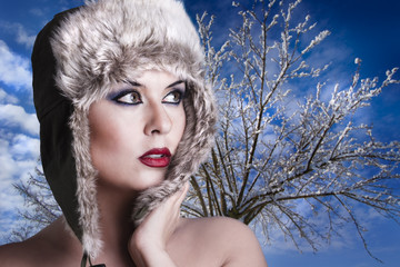 Winter woman with snow hat and intense red lips