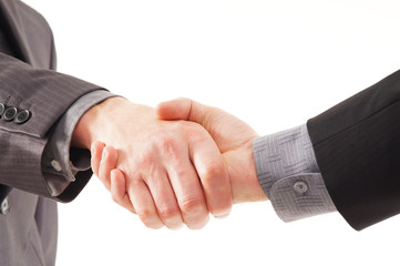 A close-up image of a handshake between two persons